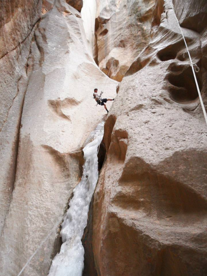 rappelling a frozen slot canyon in zion